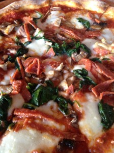 Pepperoni, spinach and mushroom pizza with mozzarella cheese!